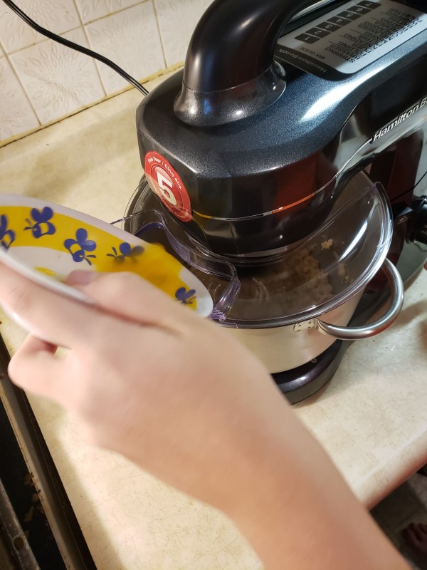 A review of Hamilton Beach Stand Mixer. Shown here is adding eggs through the splash guard while the mixer is running.